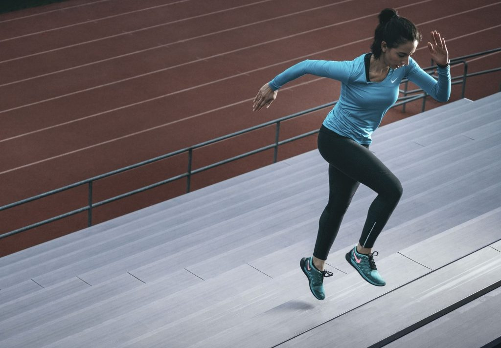 woman exercises stadium steps